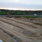 Fahrbahnen für Fundamente erstellen mit Sonnenuntergang